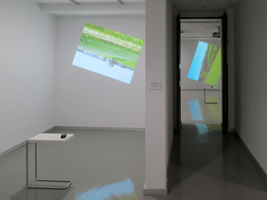 Claude Closky, 'Going Around In Circles (Bavaria)', 2013, interactive video installation, projector, stereo sound, computer, mouse, table, dimensions variable, unlimited duration. Data programming by Jean-Noël Lafargue. Exhibition view 'Dönüp durmak [Going Around in Circles]', Yeni Medya Sanatları Galerisi, Istanbul. 11 April - 1 June 2013. Curated by Ali Akay